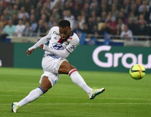 Lyon's French forward Alexandre Lacazette shoots the ball during the French L1 football match Olympique Lyonnais and AS Monaco on May 7, 2016, at the New Stadium in Decines-Charpieu near Lyon, southeastern France.      AFP PHOTO/PHILIPPE DESMAZES / AFP / PHILIPPE DESMAZES        (Photo credit should read PHILIPPE DESMAZES/AFP/Getty Images)