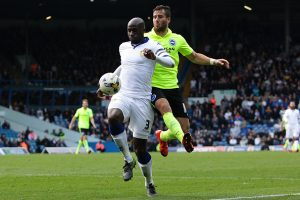 LEEDS, ENGLAND - OCTOBER 17: Tomer Hemed of Brighton & Hove Albion FC jumps on the back of Souleman Bamba (c) of Leeds United FC during the Sky Bet Championship match between Leeds United and Brighton & Hove Albion at Elland Road on October 17, 2015 in Leeds, England.  (Photo by Daniel Smith/Getty Images)