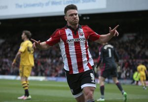 BRENTFORD, ENGLAND - APRIL 30: Scott Hogan of Brentford celebrates scoring during the Sky Bet Championship match between Brentford and Fulham at Griffin Park on April 30, 2016 in Brentford, United Kingdom. (Photo by Harry Murphy/Getty Images)