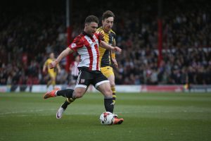 BRENTFORD, ENGLAND - APRIL 30: Scott Hogan of Brentford scores their second during the Sky Bet Championship match between Brentford and Fulham at Griffin Park on April 30, 2016 in Brentford, United Kingdom. (Photo by Harry Murphy/Getty Images)