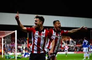 BRENTFORD, ENGLAND - APRIL 19:  Scott Hogan of Brentford FC celebrates scoring the 1st  goal during the Sky Bet Championship match between Brentford and Cardiff City on April 19, 2016 in Brentford, United Kingdom.  (Photo by Justin Setterfield/Getty Images)