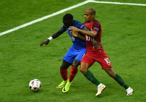 PARIS, FRANCE - JULY 10: Bacary Sagna of France and Joao Mario of Portugal challenge for the ball during the UEFA EURO 2016 Final match between Portugal and France at Stade de France on July 10, 2016 in Paris, France.  (Photo by Dan Mullan/Getty Images)
