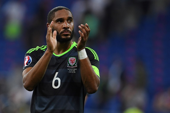 Wales' defender Ashley Williams reacts at the end of the Euro 2016 semi-final football match between Portugal and Wales at the Parc Olympique Lyonnais stadium in Décines-Charpieu, near Lyon, on July 6, 2016.  / AFP / PAUL ELLIS        (Photo credit should read PAUL ELLIS/AFP/Getty Images)