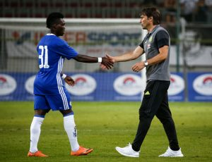 VELDEN, AUSTRIA - JULY 20:  Head coach Antonio Konte (R) of Chelsea shake hands with the Christian Atsu (L) after the international friendly match between WAC RZ Pellets and Chelsea F.C. at Worthersee Stadion on July 20, 2016 in Velden, Austria. (Photo by Srdjan Stevanovic/Getty Images)