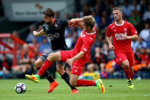 OLDENZAAL, NETHERLANDS - JULY 27: Joachim Andersen of Enschede (R) challenges Jay Rodriguez of Southampton (L) during the friendly match between Twente Enschede and FC Southampton at Q20 Stadium on July 27, 2016 in Oldenzaal, Netherlands.  (Photo by Christof Koepsel/Getty Images)