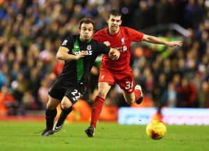 LIVERPOOL, ENGLAND - JANUARY 26:  Xherdan Shaqiri of Stoke City and Jon Flanagan of Liverpool chase the ball during the Capital One Cup semi final second leg match between Liverpool and Stoke City at Anfield on January 26, 2016 in Liverpool, England.  (Photo by Clive Brunskill/Getty Images)