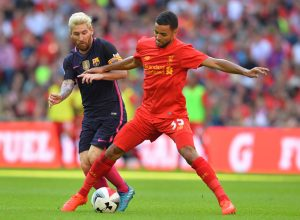 Liverpool's English defender Kevin Stewart (R) vies with Barcelona's Argentinian striker Lionel Messi during the pre-season International Champions Cup football match between Spanish champions, Barcelona and Liverpool at Wembley stadium in London on August 6, 2016. / AFP / Glyn KIRK        (Photo credit should read GLYN KIRK/AFP/Getty Images)