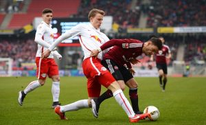 NUREMBERG, GERMANY - MARCH 20: Lukas Klostermann (L) of Leipzig and Tim Leibold of Nuernberg compete for the ball during the Second Bundesliga match between 1. FC Nuernberg and RB Leipzig at Grundig-Stadion on March 20, 2016 in Nuremberg, Germany.  (Photo by Micha Will/Bongarts/Getty Images)