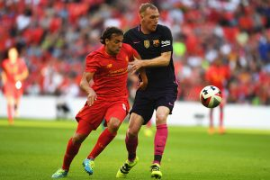 LONDON, ENGLAND - AUGUST 06: Jeremy Mathieu of Barcelona and Lazar Markovic of Liverpool in action  during the International Champions Cup match between Liverpool and Barcelona at Wembley Stadium on August 6, 2016 in London, England.  (Photo by Mike Hewitt/Getty Images)