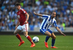 BRIGHTON, ENGLAND - AUGUST 12:  Glenn Murray of Brighton and Hove Albion in action as Oliver Burke of Nottingham Forest looks on during the Sky Bet Championship match between Brighton & Hove Albion and Nottingham Forest at Amex Stadium on August 12, 2016 in Brighton, England.  (Photo by Mike Hewitt/Getty Images)
