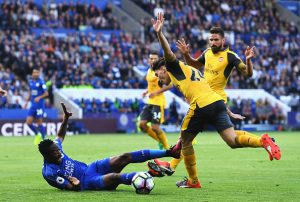 LEICESTER, ENGLAND - AUGUST 20: Ahmed Musa of Leicester City is challenged by Hector Bellerin of Arsenal during the Premier League match between Leicester City and Arsenal at The King Power Stadium on August 20, 2016 in Leicester, England.  (Photo by Michael Regan/Getty Images)