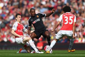 LONDON, ENGLAND - APRIL 02:  Odion Ighalo of Watford battles with Laurent Koscielny of Arsenal and Mohamed Elneny of Arsenal during the Barclays Premier League match between Arsenal and Watford at the Emirates Stadium on April 2, 2016 in London, England.  (Photo by Julian Finney/Getty Images)