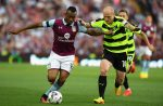 BIRMINGHAM, ENGLAND - AUGUST 16:  Jordan Ayew of Aston Villa holds off Aaron Mooy of Huddersfield Town during the Sky Bet Championship match between Aston Villa and Huddersfield Town at Villa Park on August 16, 2016 in Birmingham, England.  (Photo by Stu Forster/Getty Images)