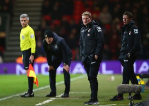 BOURNEMOUTH, ENGLAND - JANUARY 12:  Slaven Bilic manager of West Ham United (2L) and Eddie Howe manager of Bournemouth (2R) look on from the touchline during the Barclays Premier League match between A.F.C. Bournemouth and West Ham United at Vitality Stadium on January 12, 2016 in Bournemouth, England.  (Photo by Clive Rose/Getty Images)