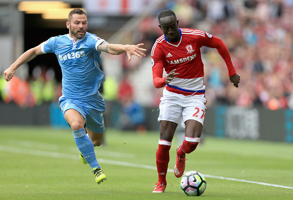 MIDDLESBROUGH, ENGLAND - AUGUST 13:  Phillip Bardsley of Stoke City battle for possession with Albert Adomah of Middlesbrough during the Premier League match between Middlesbrough and Stoke City at Riverside Stadium on August 13, 2016 in Middlesbrough, England.  (Photo by Stephen Pond/Getty Images)