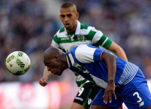 Porto's Dutch defender Bruno Martins Indi (L) heads the ball next to Sporting's Algerian forward Islam Slimani during the Portuguese league football match FC Porto vs Sporting CP at the Dragao stadium in Porto on April 30, 2016. / AFP / MIGUEL RIOPA        (Photo credit should read MIGUEL RIOPA/AFP/Getty Images)