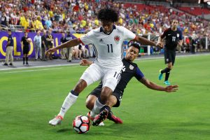GLENDALE, AZ - JUNE 25:  Juan Cuadrado #11 of Colombia is tackled by Michael Orozco #14 of United States during the first half of the 2016 Copa America Centenario third place match at University of Phoenix Stadium on June 25, 2016 in Glendale, Arizona.  (Photo by Christian Petersen/Getty Images)