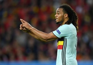 LILLE, FRANCE - JULY 01: Jason Denayer of Belgium gestures during the UEFA EURO 2016 quarter final match between Wales and Belgium at Stade Pierre-Mauroy on July 1, 2016 in Lille, France.  (Photo by Matthias Hangst/Getty Images)