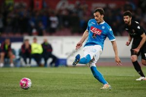 Napoli's Italian forward Manolo Gabbiadini scores a penalty during the Italian Serie A football match SSC Napoli vs Bologna FC on April 19, 2016 at the San Paolo stadium in Naples.  / AFP / CARLO HERMANN        (Photo credit should read CARLO HERMANN/AFP/Getty Images)
