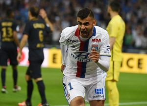 Lyon's French Algerian midfielder Rachid Ghezzal reacts after scoring during the French L1 football match Olympique Lyonnais and AS Monaco on May 7, 2016, at the New Stadium in Decines-Charpieu near Lyon, southeastern France.      AFP PHOTO/PHILIPPE DESMAZES / AFP / PHILIPPE DESMAZES        (Photo credit should read PHILIPPE DESMAZES/AFP/Getty Images)