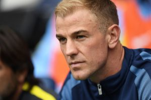 Manchester City's English goalkeeper Joe Hart sits on the substitutes bench for the English Premier League football match between Manchester City and Sunderland at the Etihad Stadium in Manchester, north west England, on August 13, 2016. Manchester City manager Pep Guardiola dropped goalkeeper Joe Hart in favour of Willy Caballero for his opening Premier League game against Sunderland on August 13. / AFP / PAUL ELLIS / RESTRICTED TO EDITORIAL USE. No use with unauthorized audio, video, data, fixture lists, club/league logos or 'live' services. Online in-match use limited to 75 images, no video emulation. No use in betting, games or single club/league/player publications.  /         (Photo credit should read PAUL ELLIS/AFP/Getty Images)