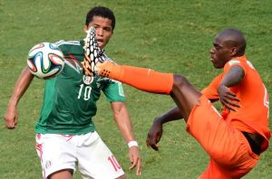 Mexico's forward Giovani Dos Santos (L) and Netherlands' defender Bruno Martins Indi vie for the ball during a Round of 16 football match between Netherlands and Mexico at Castelao Stadium in Fortaleza during the 2014 FIFA World Cup on June 29, 2014. AFP PHOTO / JAVIER SORIANO        (Photo credit should read JAVIER SORIANO/AFP/Getty Images)