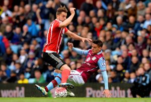 BIRMINGHAM, ENGLAND - APRIL 23:  Ashley Westwood of Aston Villa makes a tackle on Jay Rodriguez of Southampton during the Barclays Premier League match between Aston Villa and Southampton at Villa Park on April 23, 2016 in Birmingham, United Kingdom.  (Photo by Gareth Copley/Getty Images)