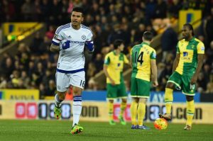 Chelsea's Brazilian striker Kenedy (L) celebrates scoring the opening goal in the first minute of the English Premier League football match between Norwich City and Chelsea at Carrow Road in Norwich, eastern England, on March 1, 2016.   / AFP / BEN STANSALL / RESTRICTED TO EDITORIAL USE. No use with unauthorized audio, video, data, fixture lists, club/league logos or 'live' services. Online in-match use limited to 75 images, no video emulation. No use in betting, games or single club/league/player publications.  / RESTRICTED TO EDITORIAL USE. NO USE WITH UNAUTHORIZED AUDIO, VIDEO, DATA, FIXTURE LISTS, CLUB/LEAGUE LOGOS OR 'LIVE' SERVICES. ONLINE IN-MATCH USE LIMITED TO 75 IMAGES, NO VIDEO EMULATION. NO USE IN BETTING, GAMES OR SINGLE CLUB/LEAGUE/PLAYER PUBLICATIONS.        (Photo credit should read BEN STANSALL/AFP/Getty Images)