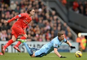 "Manchester City's Bosnian striker Edin Dzeko (R) vies with Liverpool's Serbian midfielder Lazar Markovic during the English Premier League football match between Liverpool and Manchester City at the Anfield stadium in Liverpool, north west England, on March 1, 2015. AFP PHOTO / OLI SCARFF  RESTRICTED TO EDITORIAL USE. NO USE WITH UNAUTHORIZED AUDIO, VIDEO, DATA, FIXTURE LISTS, CLUB/LEAGUE LOGOS OR ""LIVE"" SERVICES. ONLINE IN-MATCH USE LIMITED TO 45 IMAGES, NO VIDEO EMULATION. NO USE IN BETTING, GAMES OR SINGLE CLUB/LEAGUE/PLAYER PUBLICATIONS.        (Photo credit should read OLI SCARFF/AFP/Getty Images)"
