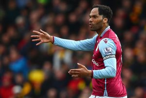 WATFORD, ENGLAND - APRIL 30:  Joleon Lescott of Aston Villa reacts during the Barclays Premier League match between Watford and Aston Villa at Vicarage Road on April 30, 2016 in Watford, England.  (Photo by Clive Rose/Getty Images)