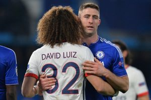 Chelsea's English defender Gary Cahill (R) embraces Paris Saint-Germain's Brazilian defender David Luiz (L) at the end of the UEFA Champions League round of 16 second leg football match between Chelsea and Paris Saint-Germain (PSG) at Stamford Bridge in London on March 9, 2016.  / AFP / GLYN KIRK        (Photo credit should read GLYN KIRK/AFP/Getty Images)
