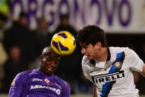 Inter Milan's defender Andrea Ranocchia (R) fights for the ball with Fiorentina's midfielder Mohamed Sissoko of Mali during the Italian Serie A football match between Fiorentina and Inter Milan at the Artemio Franchi Stadium in Florence on February 17, 2013. AFP PHOTO / GIUSEPPE CACACE        (Photo credit should read GIUSEPPE CACACE/AFP/Getty Images)