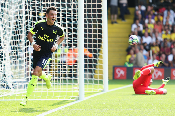WATFORD, ENGLAND - AUGUST 27:  Mesut Ozil of Arsenal scores his sides third goal during the Premier League match between Watford and Arsenal at Vicarage Road on August 27, 2016 in Watford, England.  (Photo by Christopher Lee/Getty Images)