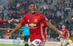 Manchester United's English striker Marcus Rashford celebrates after scoring their late winning goal during the English Premier League football match between Hull City and Manchester United at the KCOM Stadium in Kingston upon Hull, north east England on August 27, 2016. Manchester united won the game 1-0. / AFP / Lindsey PARNABY / RESTRICTED TO EDITORIAL USE. No use with unauthorized audio, video, data, fixture lists, club/league logos or 'live' services. Online in-match use limited to 75 images, no video emulation. No use in betting, games or single club/league/player publications.  /         (Photo credit should read LINDSEY PARNABY/AFP/Getty Images)
