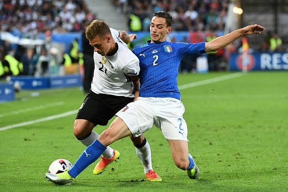 Barcelona reignite their interest in Juventus defender De Sciglio who is in action in the picture