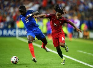 PARIS, FRANCE - JULY 10:  Moussa Sissoko of France and Renato Sanches of Portugal compete for the ball during the UEFA EURO 2016 Final match between Portugal and France at Stade de France on July 10, 2016 in Paris, France.  (Photo by Matthias Hangst/Getty Images)