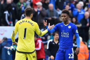 Swansea City's Polish goalkeeper Lukasz Fabianski (L) shakes hands with Leicester City's English midfielder Demarai Gray (R) after the final whistle during the English Premier League football match between Leicester City and Swansea at King Power Stadium in Leicester, central England on April 24, 2016. / AFP / BEN STANSALL / RESTRICTED TO EDITORIAL USE. No use with unauthorized audio, video, data, fixture lists, club/league logos or 'live' services. Online in-match use limited to 75 images, no video emulation. No use in betting, games or single club/league/player publications.  /         (Photo credit should read BEN STANSALL/AFP/Getty Images)