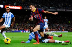 BARCELONA, SPAIN - JANUARY 26:  Cristian Tello of FC Barcelona duels for the ball with Sergio Sanchez of Malaga CF during the La Liga match between FC Barcelona and Malaga CF at Camp Nou on January 26, 2014 in Barcelona, Spain.  (Photo by David Ramos/Getty Images)
