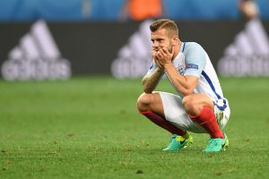 England's midfielder Jack Wilshere reacts after England lost 1-2 to Iceland in the Euro 2016 round of 16 football match between England and Iceland at the Allianz Riviera stadium in Nice on June 27, 2016.   / AFP / PAUL ELLIS        (Photo credit should read PAUL ELLIS/AFP/Getty Images)