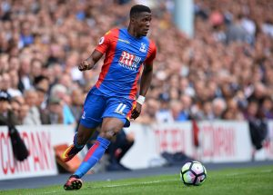 Crystal Palace's Ivorian-born English striker Wilfried Zaha runs with the ball during the English Premier League football match between Tottenham Hotspur and Crystal Palace at White Hart Lane in London, on August 20, 2016. / AFP / Glyn KIRK / RESTRICTED TO EDITORIAL USE. No use with unauthorized audio, video, data, fixture lists, club/league logos or 'live' services. Online in-match use limited to 75 images, no video emulation. No use in betting, games or single club/league/player publications.  /         (Photo credit should read GLYN KIRK/AFP/Getty Images)