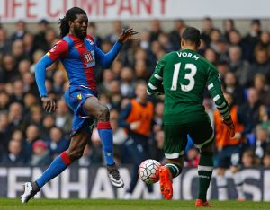 Crystal Palace's Togolese striker Emmanuel Adebayor runs in on goal as Tottenham Hotspur's Dutch goalkeeper Michel Vorm comes out to block during the FA cup fifth round football match between Tottenham Hotspur and Crystal Palace at White Hart Lane in London on February 21, 2016.  / AFP / IAN KINGTON / RESTRICTED TO EDITORIAL USE. No use with unauthorized audio, video, data, fixture lists, club/league logos or 'live' services. Online in-match use limited to 75 images, no video emulation. No use in betting, games or single club/league/player publications.  /         (Photo credit should read IAN KINGTON/AFP/Getty Images)