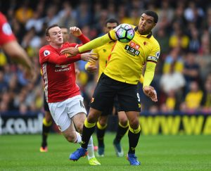 WATFORD, ENGLAND - SEPTEMBER 18: Troy Deeney of Watford battles with Wayne Rooney of Manchester United during the Premier League match between Watford and Manchester United at Vicarage Road on September 18, 2016 in Watford, England.  (Photo by Laurence Griffiths/Getty Images)