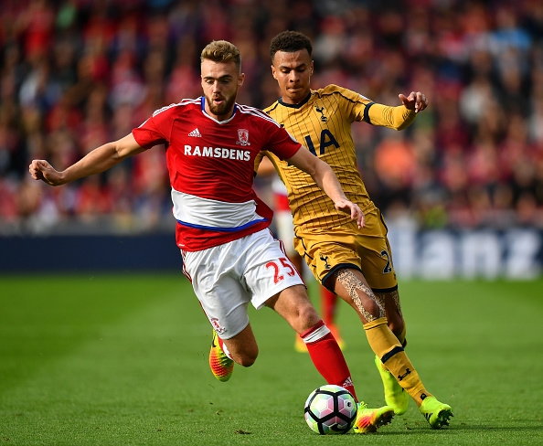 MIDDLESBROUGH, ENGLAND - SEPTEMBER 24:  Calum Chambers of Middlesbrough holds off Dele Alli of Tottenham Hotspur during the Premier League match between Middlesbrough and Tottenham Hotspur at the Riverside Stadium on September 24, 2016 in Middlesbrough, England.  (Photo by Dan Mullan/Getty Images)