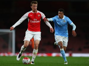 LONDON, ENGLAND - APRIL 04:  Krystian Bielik of Arsenal battles with Lukas Nmecha of Man City during the FA Youth Cup semi-final second leg match between Arsenal and Manchester City at Emirates Stadium on April 4, 2016 in London, England.  (Photo by Julian Finney/Getty Images)