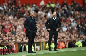 Manchester United's Portuguese manager Jose Mourinho (L) and Manchester City's Spanish manager Pep Guardiola (R) watch from the touchline during the English Premier League football match between Manchester United and Manchester City at Old Trafford in Manchester, north west England, on September 10, 2016. / AFP / Oli SCARFF / RESTRICTED TO EDITORIAL USE. No use with unauthorized audio, video, data, fixture lists, club/league logos or 'live' services. Online in-match use limited to 75 images, no video emulation. No use in betting, games or single club/league/player publications.  /         (Photo credit should read OLI SCARFF/AFP/Getty Images)