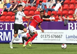 LONDON, ENGLAND - AUGUST 13:  Ezri Konsa of Charlton Athletic looks to the ball with Alex Revell of Northampton Town during the Sky Bet League One match between Charlton Athletic and Northampton Town at The Valley on August 13, 2016 in London, England.  (Photo by Pete Norton/Getty Images)