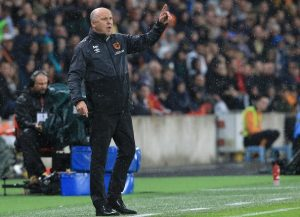 Hull City's caretaker manager Mike Phelan gestures from the touchline during the English Premier League football match between Hull City and Manchester United at the KCOM Stadium in Kingston upon Hull, north east England on August 27, 2016. Manchester united won the game 1-0. / AFP / Lindsey PARNABY / RESTRICTED TO EDITORIAL USE. No use with unauthorized audio, video, data, fixture lists, club/league logos or 'live' services. Online in-match use limited to 75 images, no video emulation. No use in betting, games or single club/league/player publications.  /         (Photo credit should read LINDSEY PARNABY/AFP/Getty Images)