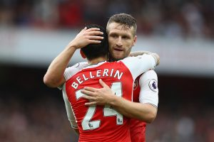 LONDON, ENGLAND - SEPTEMBER 10: Hector Bellerin of Arsenal and Shkodran Mustafi of Arsenal embrace after the match during the Premier League match between Arsenal and Southampton at Emirates Stadium on September 10, 2016 in London, England.  (Photo by Paul Gilham/Getty Images)