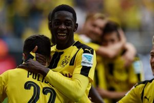 Dortmund's French midfielder Ousmane Dembele (C) celebrates during the German first division Bundesliga football match of Borussia Dortmund vs SV Darmstadt 98 in Dortmund, western Germany, on September 17, 2016. / AFP / PATRIK STOLLARZ / RESTRICTIONS: DURING MATCH TIME: DFL RULES TO LIMIT THE ONLINE USAGE TO 15 PICTURES PER MATCH AND FORBID IMAGE SEQUENCES TO SIMULATE VIDEO. == RESTRICTED TO EDITORIAL USE == FOR FURTHER QUERIES PLEASE CONTACT DFL DIRECTLY AT + 49 69 650050         (Photo credit should read PATRIK STOLLARZ/AFP/Getty Images)