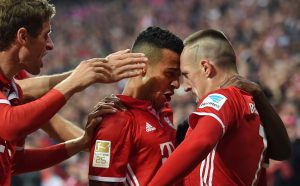 (L-R) Bayern Munich's striker Thomas Mueller, Bayern Munich's Spanish midfielder Thiago Alcantara and Bayern Munich's French midfielder Franck Ribery celebrate after Ribery scored during the German first division Bundesliga football match between FC Bayern Munich and Hertha Berlin in Munich, southern Germany, on September 21, 2016. / AFP / CHRISTOF STACHE / RESTRICTIONS: DURING MATCH TIME: DFL RULES TO LIMIT THE ONLINE USAGE TO 15 PICTURES PER MATCH AND FORBID IMAGE SEQUENCES TO SIMULATE VIDEO. == RESTRICTED TO EDITORIAL USE == FOR FURTHER QUERIES PLEASE CONTACT DFL DIRECTLY AT + 49 69 650050         (Photo credit should read CHRISTOF STACHE/AFP/Getty Images)